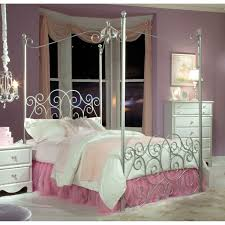 victorian style silver metal canopy bed using white bed sheet and
