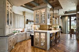 large kitchen features custom woodwork and hanging cabinets in