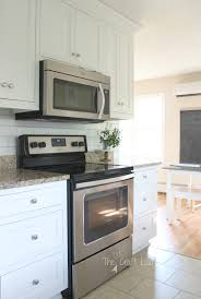 temporary kitchen backsplash white subway tile temporary backsplash the tutorial the