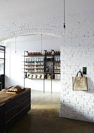 exposed brick wall painted white concrete floor aged wood and