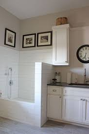 best 25 dog shower ideas on pinterest dog wash dog washing burrows cabinets white painted laundry room cabinets with tiled dog shower