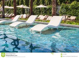 Pool Chaise Chaise Lounge In Swimming Pool Stock Photo Image 34379980
