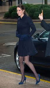 kate shows off toned legs in short skirt