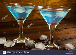 blue cocktails two blue cocktails in glasses on dark wooden background blue