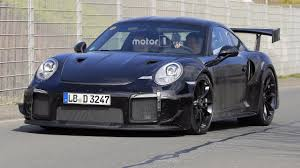 porsche 911 supercar watch the new porsche 911 gt2 rs attack the nurburgring