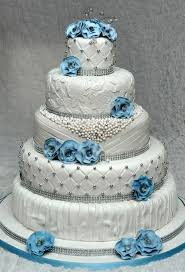 edible bling 5 tier wedding cake with edible pearls and lace decorated with