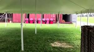 party tent rental 30x60 pole tent next to a 20x40 party canopy