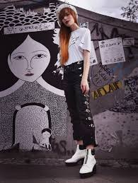 biker pants street style with delicate accessories rough and