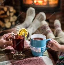 warming and relaxing near fireplace with a cup of drink