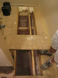 how to cut through subfloor level an uneven crowning subfloor by planing sanding joists