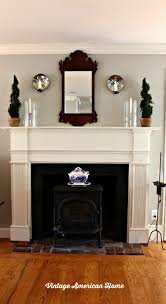 paint color for my dining room vintage american home mantel with navajo white by benjamin moore paint revere pewter chippendale mirror in dining