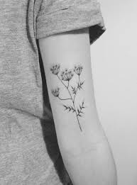 minimalist tattoo bicep flower tattoo on the left bicep