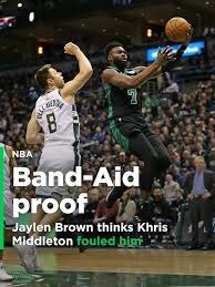 queen elizabeth ii beams after winning a a 98 voucher from jaylen brown thinks khris middleton fouled him has the band aid to
