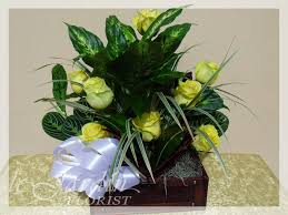 treasure chest flower arrangement with live plants and fresh cut roses