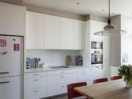 white drawers kitchen cabinets taupe wall pink tulips medium wood