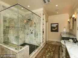 traditional master bathroom with flush u0026 rain shower head in