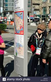 Maps For Directions Asian Tourists Checking An Information Post With Map For