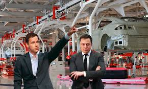 tesla factory uh oh peter thiel keeps asking elon musk what race the robots at