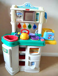toys r us fisher price table fisher price servin surprises kitchen table canada accessories