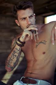 10 reasons why we find with tattoos attractive