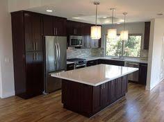 transitional kitchen with pendant light hardwood floors l shaped