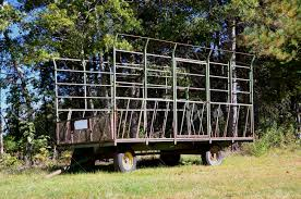 caged hay wagon used to catch bales from a baler thrower whey