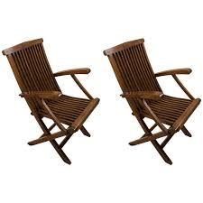 four teak folding deck chairs from mid century cruise ship deck