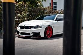 red bmw bmw m4 with red adv10 mv 2 cs wheels installed