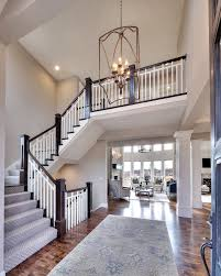 Home Entrance Decor Entry Curved Staircase Open Floor Plan Overlook From The Upper
