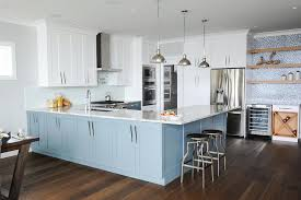 white and blue kitchen with light blue glass tile backsplash