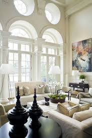 High Ceiling Living Room by Living Room With High Ceiling And Sofas Also Floor Lamps Buying