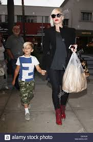Carrying Halloween Costume Gwen Stefani Walking Dr Martens Cherry Red Boots Carrying