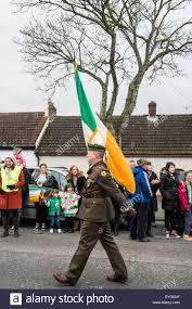 Flag Of Dublin Ireland An Irish Army Soldier Carries The Irish Flag In The Saint
