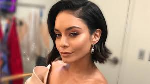 new hairstyle vanessa hudgens has a new haircut with bangs wavy locks