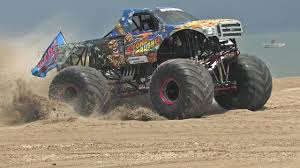 monsters truck videos stone crusher monster truck freestyle monsters on the beach 2013
