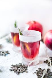 holiday cocktail recipes pomegranate drop with rosemary feasting at home