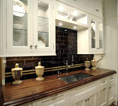 wood countertops white cabinets black backsplash new house