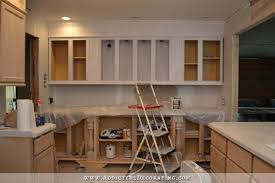 how to paint unfinished cabinets white prepping kitchen cabinets for paint a k a why i don t