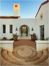 exterior spanish style home clayterracotta tile roof white photo