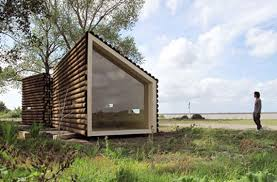 cabin design olgga s portable log cabin conceals a sleek modern interior
