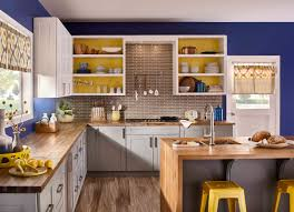blue kitchen cabinets and yellow walls color of the month colorfully behr