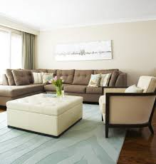 living room gray benches white chaise lounges gray sofa white