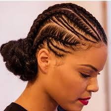 cruise hairstyles for black women freehand cornrows wrapped into a low bun natural hair style