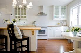 2 stools and led illuminated cabinet kitchen backsplash ideas for