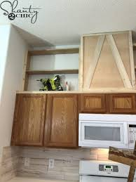 how to make cabinets appear taller how to make cabinets taller free plans tutorial