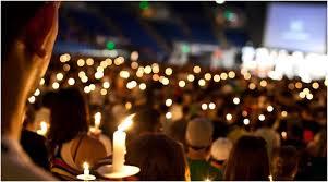 a candle lighting ceremony next memorials
