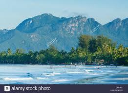 pantai cenang beach langkawi island malaysia blue sky clouds tree