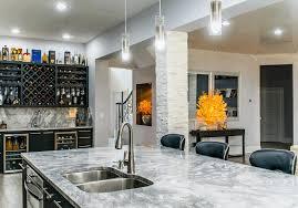 marble backsplash kitchen black wood wine cabinet black bar stools white wall painting dark