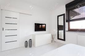 White Furniture In Bedroom Vibrant Cottage White Commode And Black Tv In Bedroom Stock