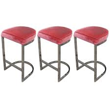set of three cantilevered milo baughman chrome bar stools